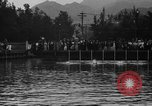 Image of swimming race Hawaii USA, 1916, second 4 stock footage video 65675071572