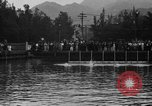 Image of swimming race Hawaii USA, 1916, second 7 stock footage video 65675071572
