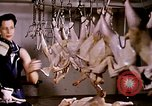 Image of harvesting chickens fruits and vegatables United States USA, 1956, second 2 stock footage video 65675071652