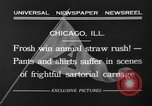 Image of shirts torn off during annual Straw Race Chicago Illinois USA, 1932, second 5 stock footage video 65675071663