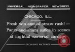 Image of shirts torn off during annual Straw Race Chicago Illinois USA, 1932, second 9 stock footage video 65675071663