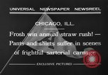Image of shirts torn off during annual Straw Race Chicago Illinois USA, 1932, second 12 stock footage video 65675071663
