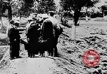 Image of mass burial Ukraine, 1944, second 9 stock footage video 65675071994