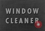 Image of window cleaner New York United States USA, 1945, second 10 stock footage video 65675072164