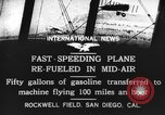 Image of mid-air refueling San Diego California USA, 1923, second 9 stock footage video 65675072184