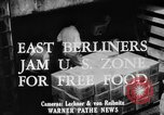 Image of Surplus food distributed for starving East Germans Germany, 1951, second 5 stock footage video 65675072259
