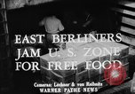 Image of Surplus food distributed for starving East Germans Germany, 1951, second 8 stock footage video 65675072259