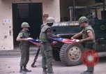 Image of U.S.  Marines enter city on Ontos antitank vehicle and M48 tank Hue Vietnam, 1968, second 2 stock footage video 65675072392