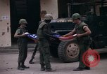 Image of U.S.  Marines enter city on Ontos antitank vehicle and M48 tank Hue Vietnam, 1968, second 4 stock footage video 65675072392