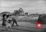 Image of civilians wait for streetcar Hiroshima Japan, 1946, second 3 stock footage video 65675072450