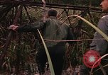 Image of recovery of LB-7 aircraft Bluefields Nicaragua, 1969, second 11 stock footage video 65675072638