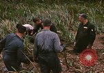 Image of recovery of LB-7 aircraft debris Bluefields Nicaragua, 1969, second 10 stock footage video 65675072642