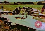 Image of German farmers work aroung a crashed U.S. Air Force P-47 in a field Germany, 1945, second 3 stock footage video 65675072706