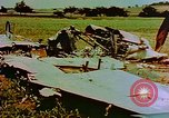 Image of German farmers work aroung a crashed U.S. Air Force P-47 in a field Germany, 1945, second 5 stock footage video 65675072706