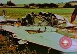 Image of German farmers work aroung a crashed U.S. Air Force P-47 in a field Germany, 1945, second 6 stock footage video 65675072706