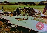 Image of German farmers work aroung a crashed U.S. Air Force P-47 in a field Germany, 1945, second 7 stock footage video 65675072706