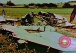 Image of German farmers work aroung a crashed U.S. Air Force P-47 in a field Germany, 1945, second 8 stock footage video 65675072706