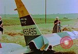 Image of German farmers work aroung a crashed U.S. Air Force P-47 in a field Germany, 1945, second 11 stock footage video 65675072706