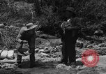 Image of gold panning Arizona United States USA, 1920, second 4 stock footage video 65675072790