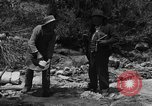 Image of gold panning Arizona United States USA, 1920, second 9 stock footage video 65675072790