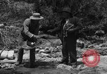 Image of gold panning Arizona United States USA, 1920, second 11 stock footage video 65675072790