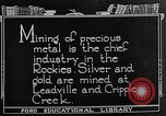Image of gold panning Leadville Colorado USA, 1922, second 4 stock footage video 65675072890