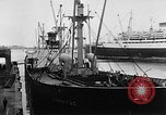 Image of arrival of coal Genoa Italy, 1947, second 5 stock footage video 65675073035