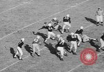 Image of football game Birmingham Alabama USA, 1954, second 9 stock footage video 65675073126