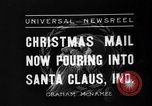 Image of children at workshop Santa Claus Indiana USA, 1936, second 3 stock footage video 65675073146