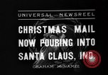 Image of children at workshop Santa Claus Indiana USA, 1936, second 8 stock footage video 65675073146