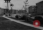 Image of apartment developments and rush hour Washington DC USA, 1950, second 12 stock footage video 65675073230