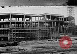 Image of school construction and suburban homes Washington DC USA, 1950, second 1 stock footage video 65675073233