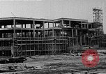 Image of school construction and suburban homes Washington DC USA, 1950, second 2 stock footage video 65675073233