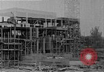 Image of school construction and suburban homes Washington DC USA, 1950, second 8 stock footage video 65675073233