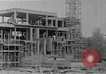 Image of school construction and suburban homes Washington DC USA, 1950, second 10 stock footage video 65675073233