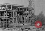 Image of school construction and suburban homes Washington DC USA, 1950, second 12 stock footage video 65675073233