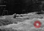 Image of canoe racing Lebanon New Hampshire USA, 1967, second 10 stock footage video 65675073300