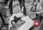 Image of mass burial Gardelegen Germany, 1945, second 2 stock footage video 65675073349