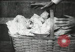 Image of thief abducts baby United States USA, 1905, second 9 stock footage video 65675073377