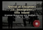 Image of Newly arriving immigrants to America  Ellis Island New York USA, 1906, second 4 stock footage video 65675073417