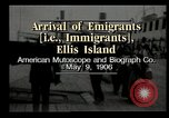 Image of Newly arriving immigrants to America  Ellis Island New York USA, 1906, second 11 stock footage video 65675073417