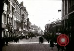 Image of Busy Russian street with pedestrians and streetcar Russia Soviet Union, 1920, second 10 stock footage video 65675073436