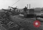 Image of tractor plows Holland Netherlands, 1954, second 8 stock footage video 65675073518