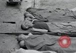 Image of emaciated corpses Germany, 1945, second 5 stock footage video 65675073860