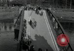 Image of German civilians, soldiers and released Allied prisoners cross bridge Grimma Germany, 1945, second 9 stock footage video 65675073902