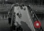 Image of German civilians, soldiers and released Allied prisoners cross bridge Grimma Germany, 1945, second 10 stock footage video 65675073902