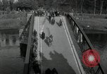 Image of German civilians, soldiers and released Allied prisoners cross bridge Grimma Germany, 1945, second 11 stock footage video 65675073902