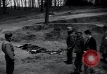 Image of unburied bodies of victims Germany, 1945, second 2 stock footage video 65675073912