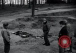 Image of unburied bodies of victims Germany, 1945, second 4 stock footage video 65675073912