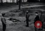 Image of unburied bodies of victims Germany, 1945, second 5 stock footage video 65675073912
